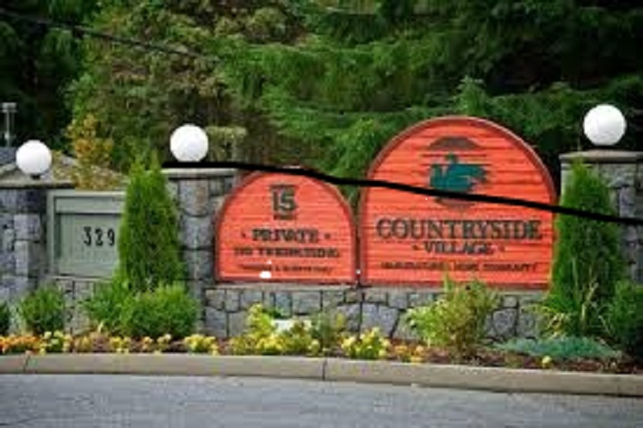 Lot for sale in Countryside Village close to Buntzen Lake. This lot sits up high in the park and would have great views from a new home with a rooftop deck. Mobile Home rents for $860.00/month.