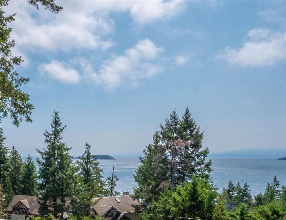 This fantastic building lot is an area of fine homes offers beautiful Southwest ocean views and full services including a community sewer system. 1 minute to beach access, 5 minutes to marinas and Smugglers Cove Provincial Park. The property has the rare and valuable feature of having more than one driveway access. The first turn off of Truman Road at the lower level and rear level access nearer the top of the property off of Ross Road - a huge plus when it comes to constructing your dream home. Build today or hold as an investment.