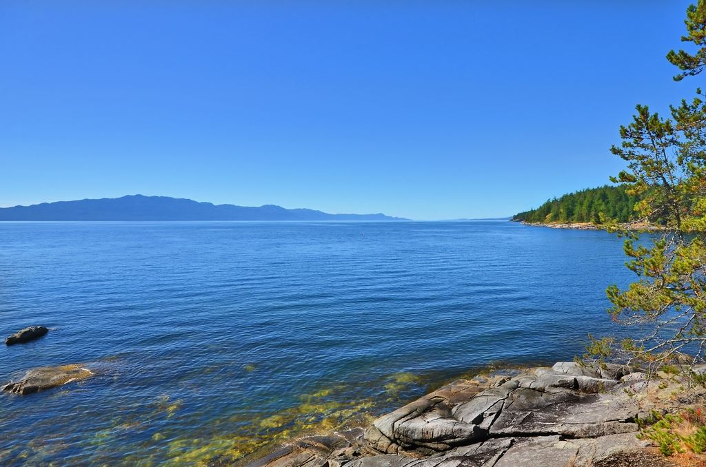 If privacy is what you're looking for, look no further. This is truly one of the most spectacular low-bank waterfront properties ever offered on the Sunshine Coast. 6.89 acres with approx. 960' of pristine shoreline, this legacy parcel enjoys perfect South-West exposure with year round sunsets. Stunning ocean views stretch 180 degrees to Thormanby Island, Texada Island & Vancouver Island. The smooth granite frontage is ideal for swimming, launching a kayak or paddling to your mooring buoy to explore the wildlife and scenery this special area is treasured for. Don't miss this rare opportunity. Sub-dividable.