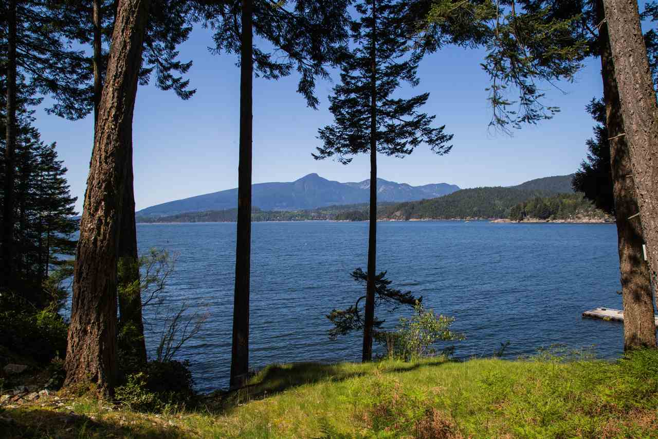 5 Acres seldom available LOW bank WATERFRONT building site in Gambier Island, nice and quiet island. 20 minutes boat ride from West Vancouver, Horseshoe Bay, located at East side of Long Bay, SOUTH WEST Facing stunning sunset view, drilled well, septic approved, can build your own private dock, zoning allow to build 2 dwellings.