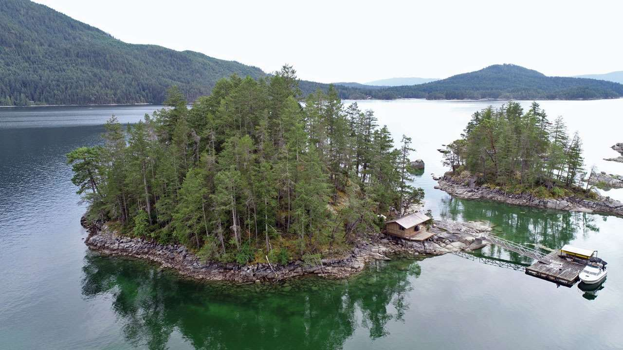 2.5 acre private island in Blind Bay commonly known as Dragonfly Island. Located between Nelson & Hardy Islands. One of the most desirable properties in all of Blind Bay. The island is covered in mature vegetation, rare for an island of this size, and has 360 degree views and ultimate sun exposure. There is roughly 1 acre of completely flat land that is perfect for the ideal building site to look out over all of Blind Bay. There is also a well-built aluminum ramp and dock system in place with a 10 x 16 ft rustic sleeping cabin. Call to book your appointment to view today.