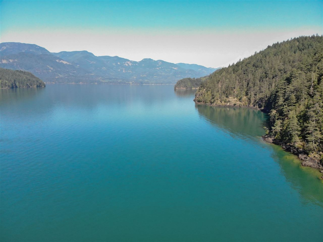 Premier waterfront lot, build your dream family cabin with south facing exposure; sunrise, all day sun, sunset and epic water views. Boat access only, however a quick 10 to 15 minute boat ride from the marina. Call your agent for more information.