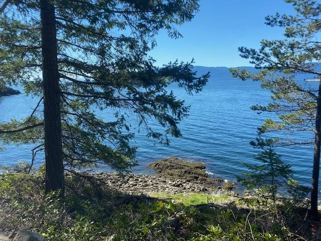 A spectacular waterfront building lot is now available in the high-end area of Daniel Point. The cleared and ready-to-build corner property offers excellent southwest sun exposure. This .69 acre property has stunning sought-after views of Malaspina Strait and Agamemnon Channel. Ready for the construction of your dream home! Sewer and services are available at the lot line. You will find easy access to the beach where you can enter the ocean to swim or launch your SUP boards and Kayaks. Watch the whales and the constant activity of vibrant marine life, and enjoy spectacular sunsets!