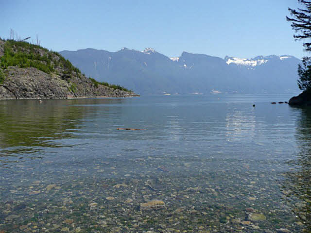 Brigade Bay Gambier Island, Lot #15, 2.25 acres of completely useable lush green vegetation with 95' of walk out level beach frontage. Picture perfect protected bay ideal for children to spend hours hunting for crabs, swimming, and building rafts while you quietly enjoy reading that book. Gently sloping toward the beach with numerous easy to develope building sites. Zoning permits 2 dwellings there is an existing drilled well. Huge views of the Bay & North Shore Mountains. A very bright lot with sun all day. Brigade Bay owners enjoy access to a private year round marina. 45 minutes from downtown Vancouver.