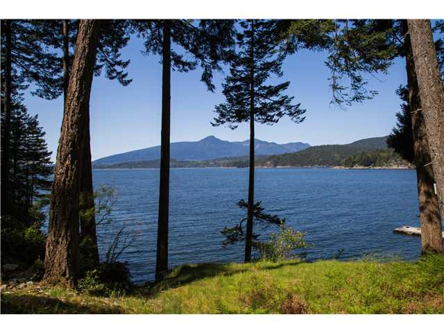5 Acres Seldom available low bank waterfront building site in Gambier Island, nice and quiet island; 20 minutes boat ride from West Vancouver Horseshoe Bay, located at East side of Long Bay, South West Facing, stunning sunset and ocean view , drilled well, septic approved, can build your own private dock, zoning allow to build 2 dwellings.