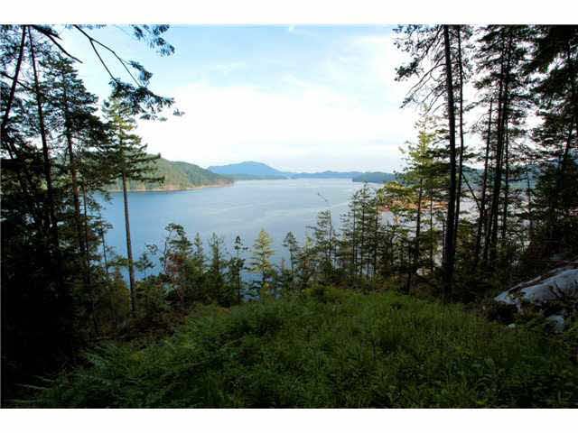 4.99 Acres of panoramic South facing views from this highbank waterfront property. Easy to develop building sites with Gambier Island & Keats Island in the foreground and Vancouver Island in the distance. There is a beautiful walking trail that traverses this property & the adjacent lots down to the waterfront where an area has been set aside to accommodate a dock for the use of select property owners. If you are not a boater this area will offer magical times for swimming, watching the grand children fishing, or merely enjoying the ever changing scenery. This property measures 342.79 at the waterfront.