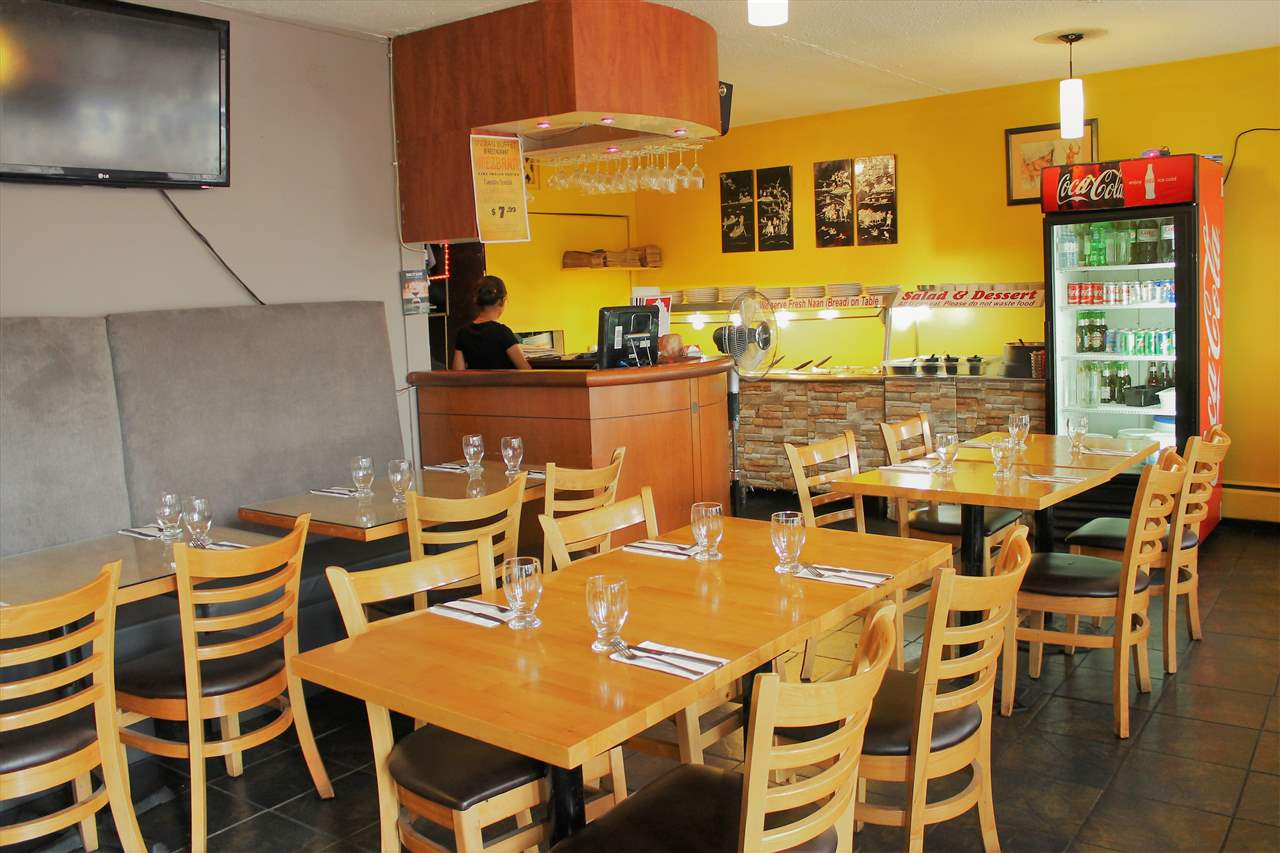 Excellent location on Kingsway in Vancouver's eastside. Well established and operating since 2009 as an Indian Restaurant with 32 seats & full liquor license. Approximately 1000 SF. 8 ft vented hood fan in commercial kitchen. GROSS RENT is $3,211.00 per month including property tax, water, garbage & GST. 3 year lease with 3 year option to renew. A confidentiality agreement is needed for all inquiries. Please do not approach owner or staff. Do not speak to staff as they are unaware of the sale. All showings to be in the morning before 11:00am.