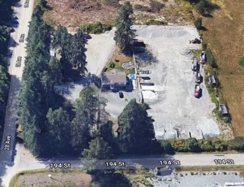 2.5 acres industrial designated property only 2 blks from development & services at Campbell Heights. Seller will rent back, if desired, and may carry some financing.