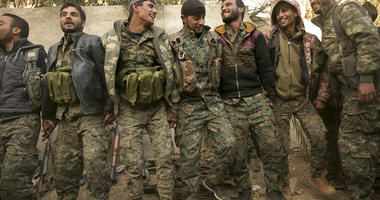 U.S.-backed Syrian Democratic Forces (SDF) fighters celebrate their territorial gains over Islamic State militants in Baghouz, Syria, move to a camp Tuesday, March 19, 2019.  (AP Photo/Maya Alleruzzo)