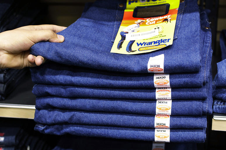 Wrangler jeans are displayed at a store in Hayward, Calif. VF Corp. says it plans to split into two publicly traded companies, with one focusing on clothing and footwear and the other concentrating on jeans and it