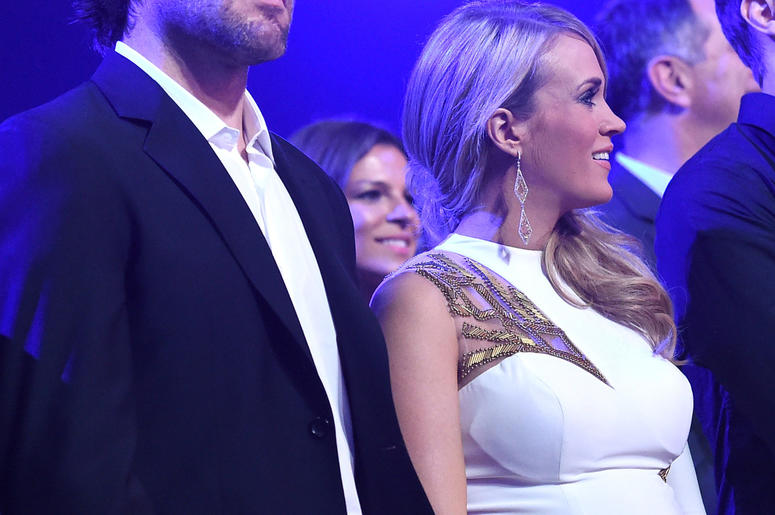 Pregnant Carrie Underwood and husband Mike Fisher at 2014 American Country Countdown Awards in Nashville