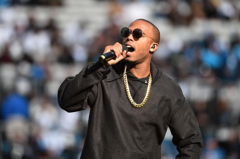 B.o.B performs at halftime of the game between the Seattle Seahawks and the Carolina Panthers