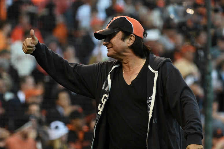 Recording artist Steve Perry gestures to the crowd before game four of the 2014 NLDS baseball playoff