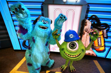 "Pixar characters Mike Wazowski, right, and Sulley greet guests at the debut of ""An Incredible Celebration"" at Disney's Hollywood Studios"