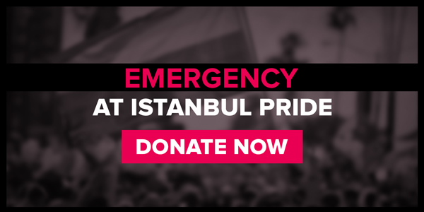 Out of focus black and white image of a protestor with a rainbow flag. Written over it is EMERGENCY AT ISTANBUL PRIDE. DONATE NOW.