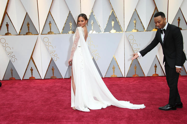 Chrissy Teigen (L) and John Legend on the red carpet during the 89th Academy Awards