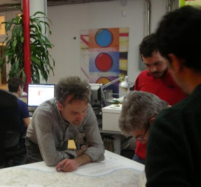 Photo of staff looking over a map