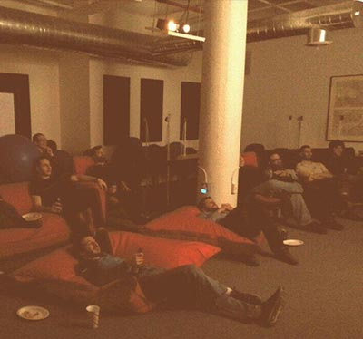 Photo of staff watching a bad movie