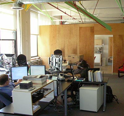 Photo of office, including a few desks