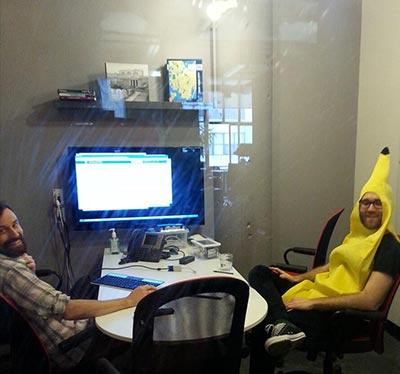 Photo of developers, one of whom is in a banana suit