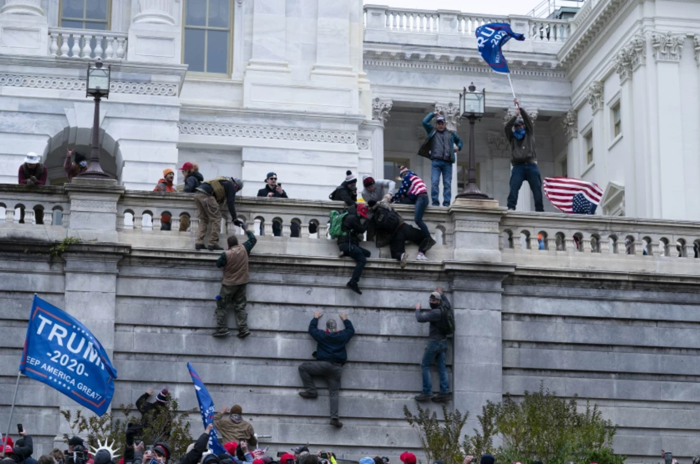 Insurrectionists attacking Capitol
