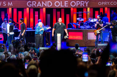 Luke Combs pauses after being surprised by John Conlee, Chris Janson and Craig Morgan with an invitation to join the Grand Ole Opry