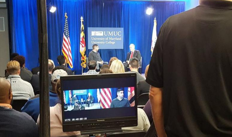 """Medal of Honor recipient Florent """"Flo"""" Groberg speaks at a UMUC event emceed by UMUC's Keith Hauk."""