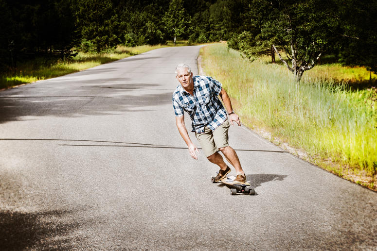 KOTA longboards founder Navy veteran Mike Maloney on one of his boards