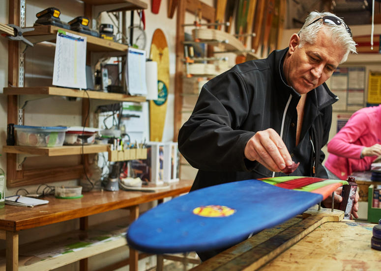 Mike Maloney Navy fighter pilot founder of KOTA Longboards shapes a board