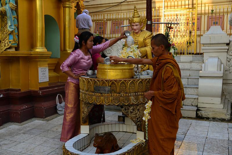 mar 07 0454 monk lady worship