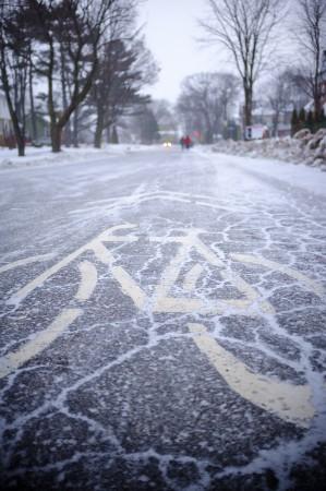 Snowy bike sign on the street