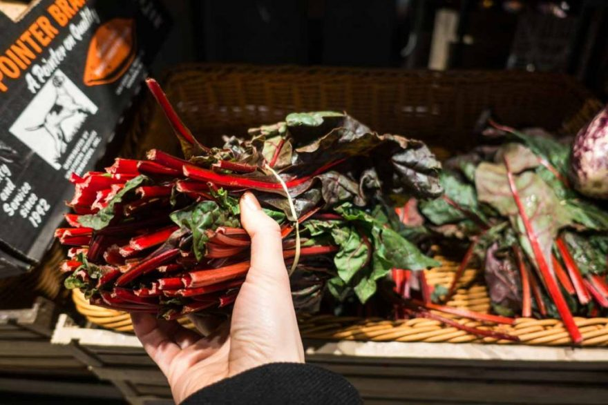 Choosing rhubarb in a grocery store