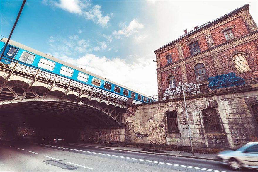 Old Abandoned Building with Steel Railway Bridge