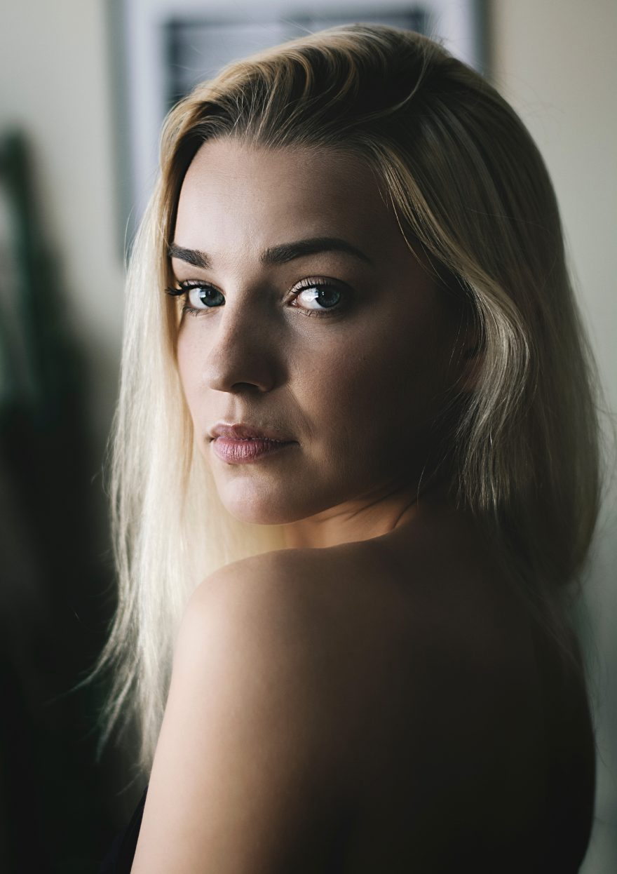 Portrait of Beautiful young Woman with bare back