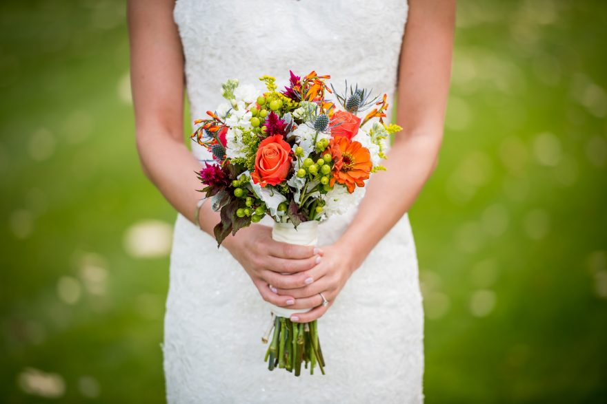 Woman in a white dress with a bouquet of flowers