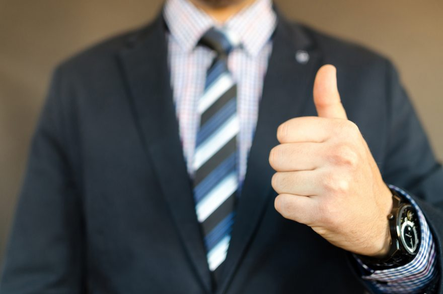 Business man in suit with thumbs up