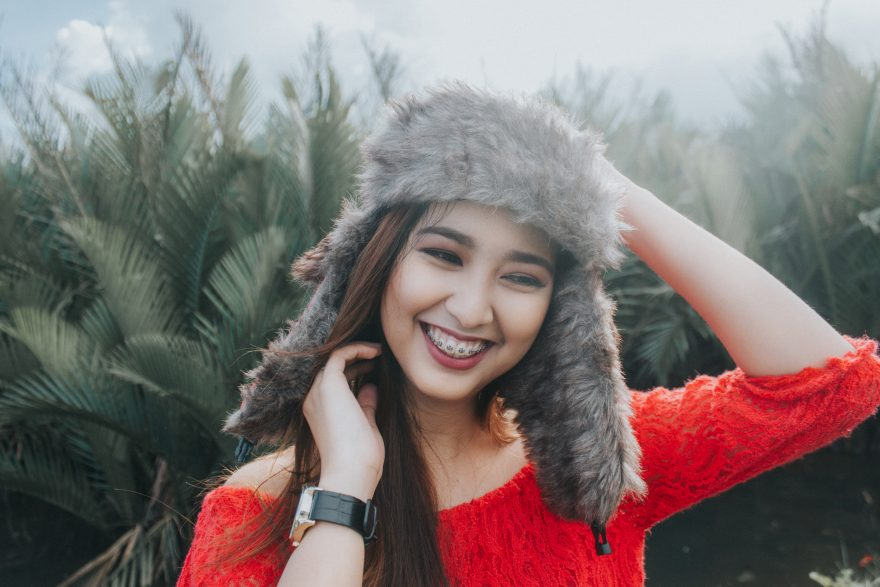 Cute girl in a fur cap smiling