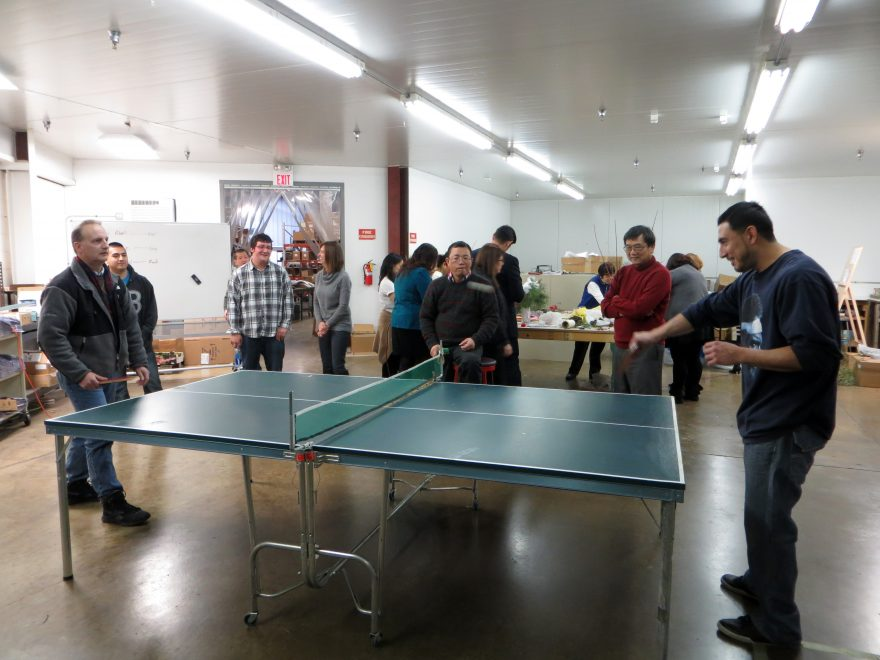 People playing Ping Pong at a Party