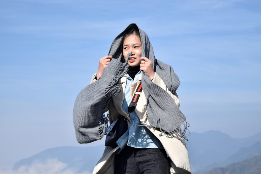 Woman with overcoat cover on her