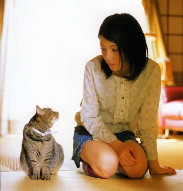 Woman and cat looking at each other