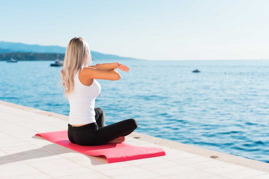 Fit Woman Stretching Her Body Before Her Morning Yoga