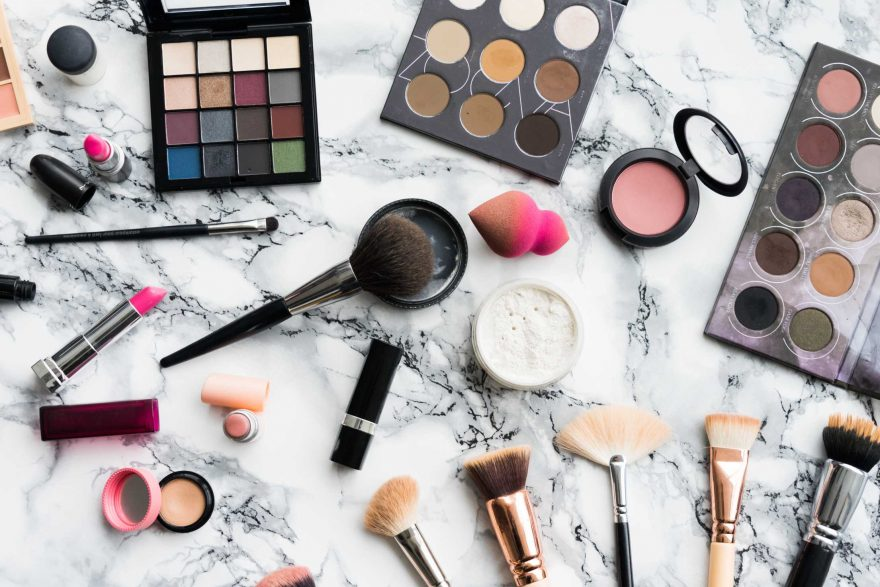Woman Beauty Makeup Set on White Marble Background