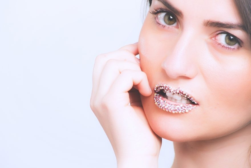 Woman model with beads on lips
