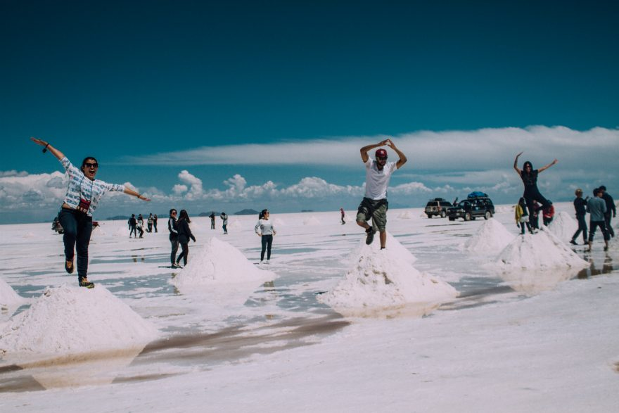 People standing on top of salt mounds