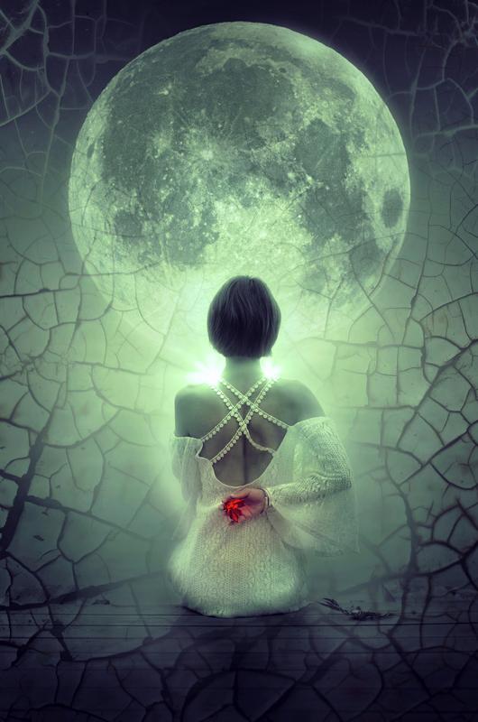 Woman looking at a large moon
