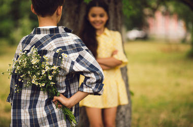 Boy Giving Girl A Flower