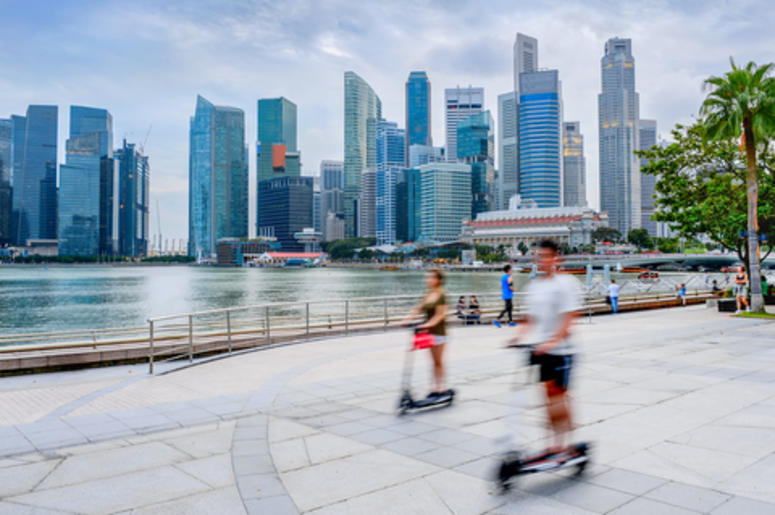 People Riding Scooters