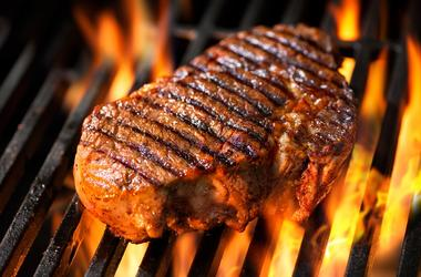 Steak sizzling on grill