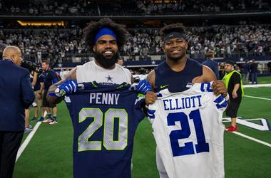 Jan 5, 2019; Arlington, TX, USA; Dallas Cowboys running back Ezekiel Elliott (left) exchanges jerseys with Seattle Seahawks running back Rashaad Penny (right) after a NFC Wild Card playoff football game at AT&T Stadium