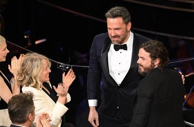 Feb 26, 2017; Hollywood, CA, USA; Ben Affleck (L) congratulates his brother Casey Affleck as Casey accepts the Oscar for Best Actor for his role in Manchester by the Sea during the 89th Academy Awards at Dolby Theatre